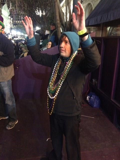 Mardi Gras David waiting for beads